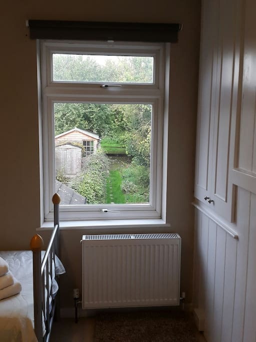 The room overlooks the garden and fields beyond
