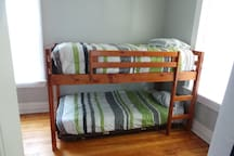 Bunk beds, and there's room for an extra air mattress in this bedroom.