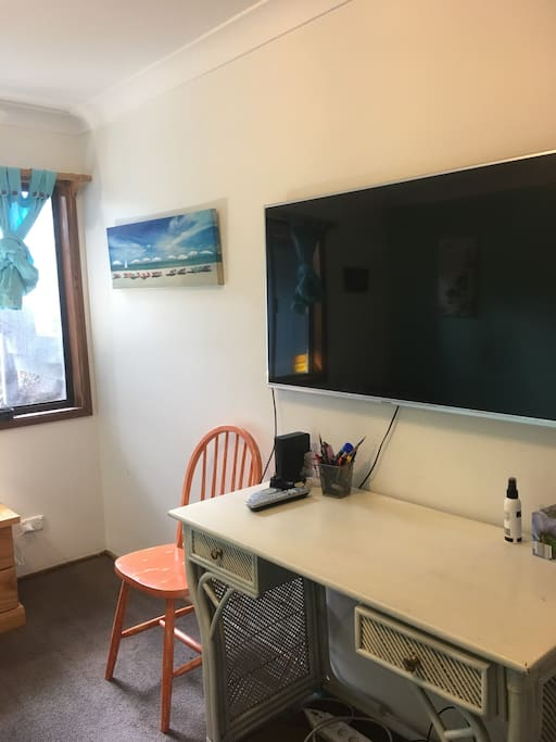 "Your own 50"" flat screen with desk for any work you may have to do in the privacy of your own room"