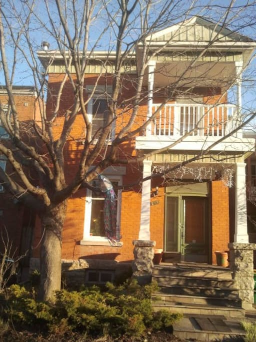 #TopDuplex wooden-balustraded colonial-style balcony of 100-year historic home!