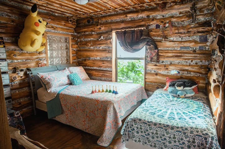 The log room is cozy. Look between the logs and you will see treasures!