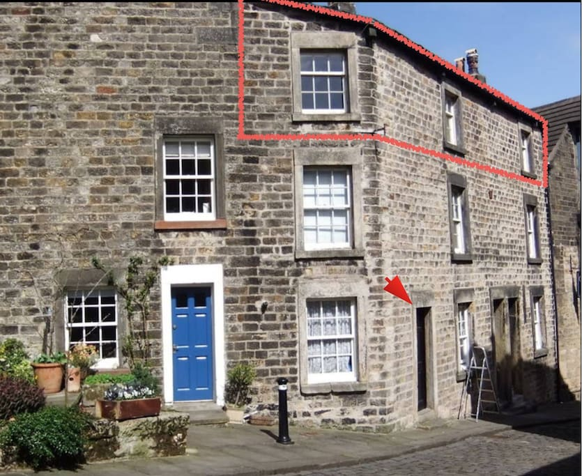 Sunny top floor flat Entry to courtyard is via the BLACK door just downhill from our neighbour's blue one (the flat is the where the three windows are at the very top of the building)