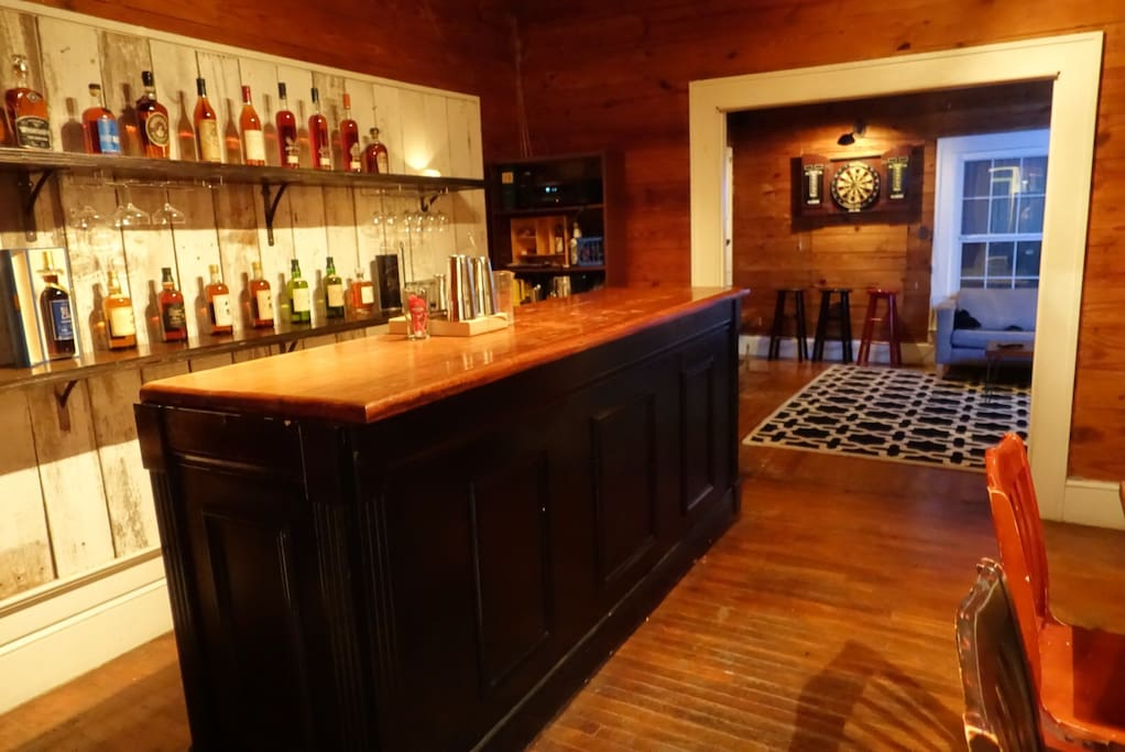 Bar room with 10ft dry bar, refrigeration, surround sound and table seating.