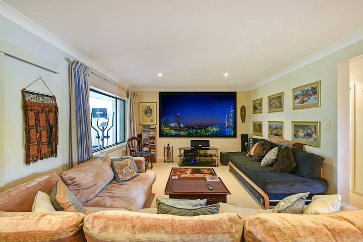 Lounge Room is very comfortable with lots of places to sit or lie while watching a movie.  Home Theatre System with very large TV screen, Foxtel and plenty of DVDs and Bluerays