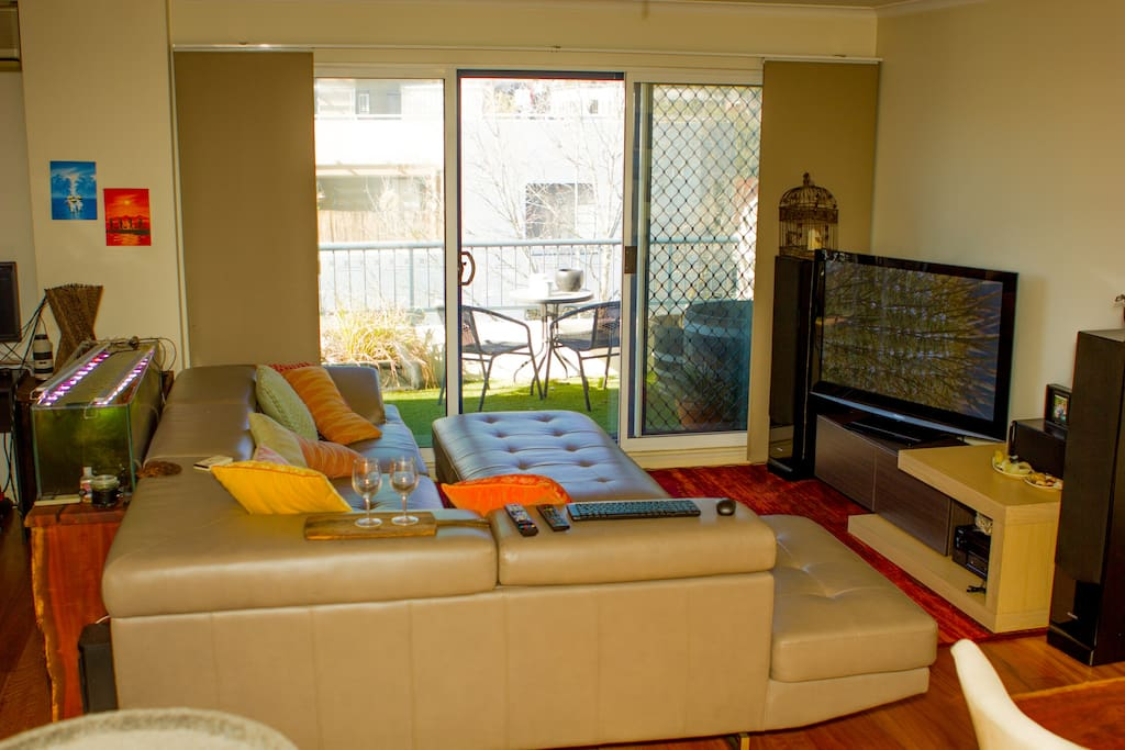 The living area which has the billabong aquarium, tv, and leads onto the beer garden as well as atrium