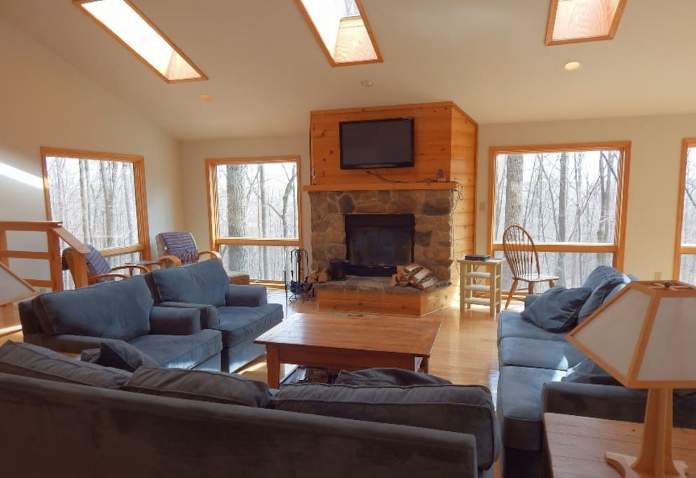 The Beautiful Open Living Room with Wood Burning Fireplace & Flat Screen TV