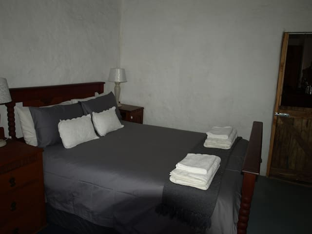 Bedroom 2 with double bed in colours of white and grey