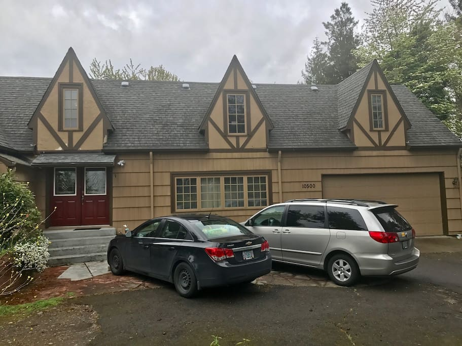 The front of the house with 2 parking spots reserve for guests.