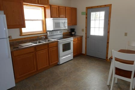 Two bedroom house with a fenced backyard. - Marquette