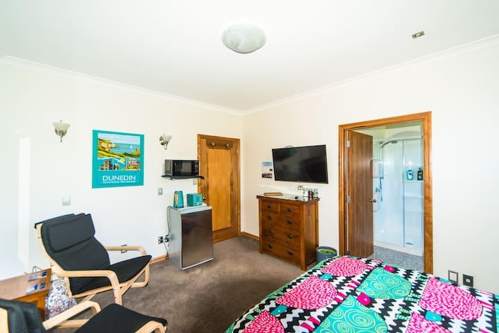 Seats, fridge, microwave, electric jug, toaster and  smart TV