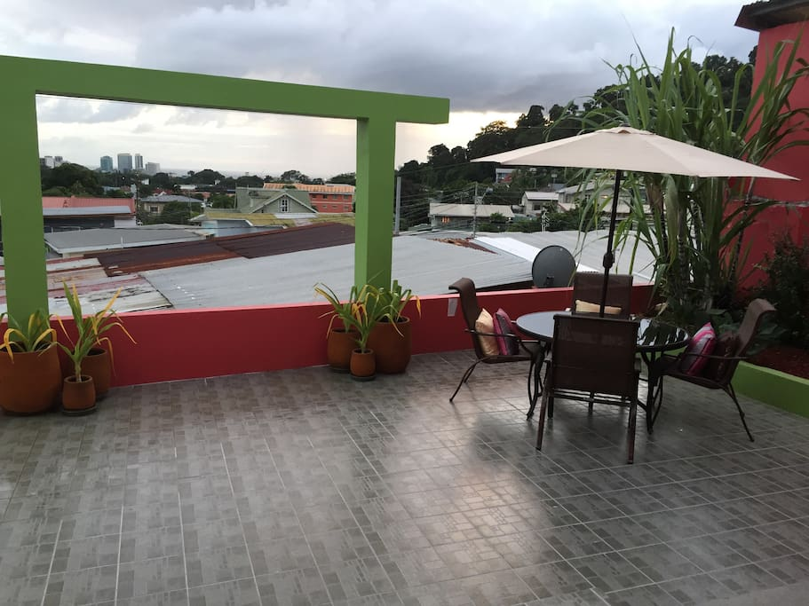 Large patio area with view of Port-of-Spain.