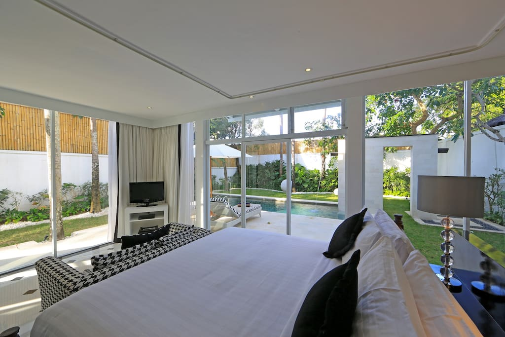 Master bedroom-King Size Bed with lush garden view and pool