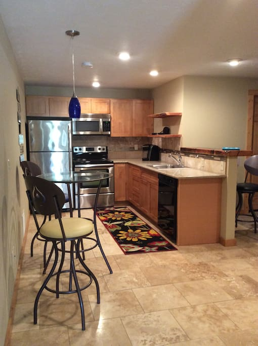 Full Kitchen with Bistro table, Refrigerator, Stove/oven, Microwave, dishwasher, Keurig.