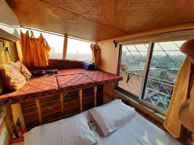 The Sundeck & the West Side window  beside the bed.