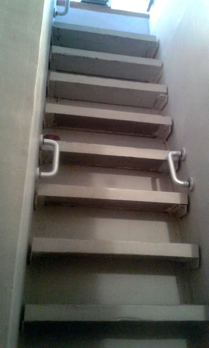 steep ship stairs into small but smart bathroom