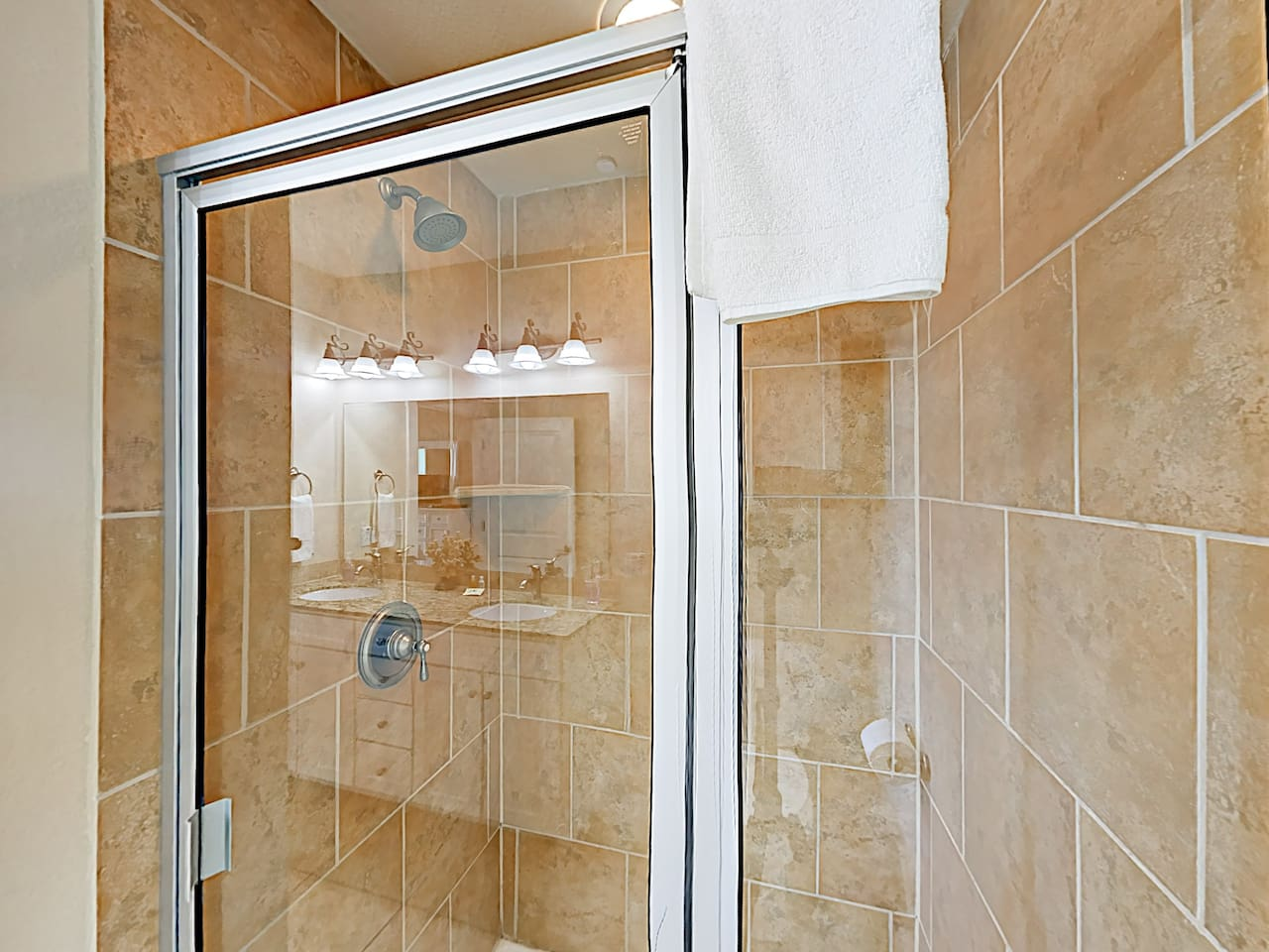 The master bathroom is equipped with a walk-in shower.
