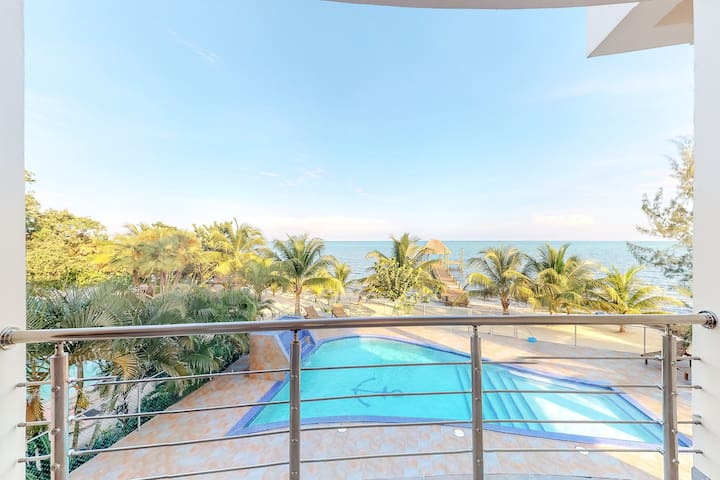 Romantic beachfront apartment with sea views and a shared pool!