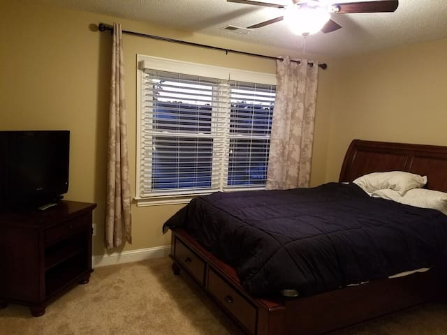 Queen Bedroom with TV closet space.