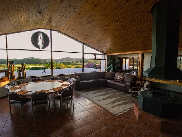 Spacious Panorama Room with ample living area and landscape view towards the orchards.