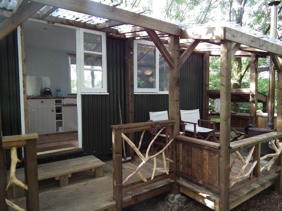 Our shepherd's hut with veranda - outdoors but sheltered!