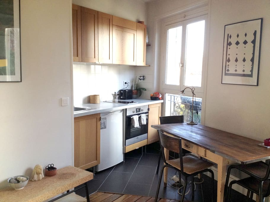All equipped kitchen and big dining table with two windows