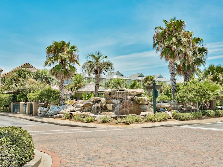 Lush Tropical Landscaping with Rock Waterfall Features in Community Common Area