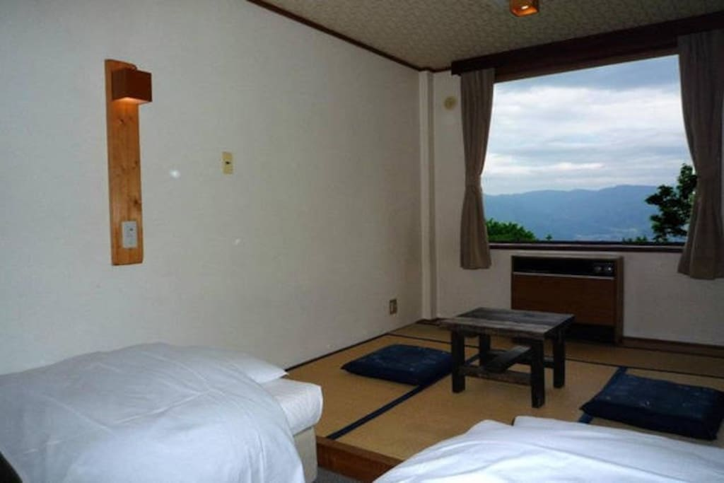 Room: This is the view of the room from the entrance. It has 2 single size beds and also 2 futons for your third and fourth guest. I can guarantee that you will enjoy it if you should decide to stay.