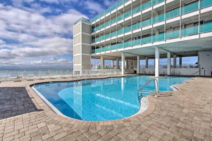 Top floor, beachfront studio w/ a shared, outdoor pool, large decks, & views!