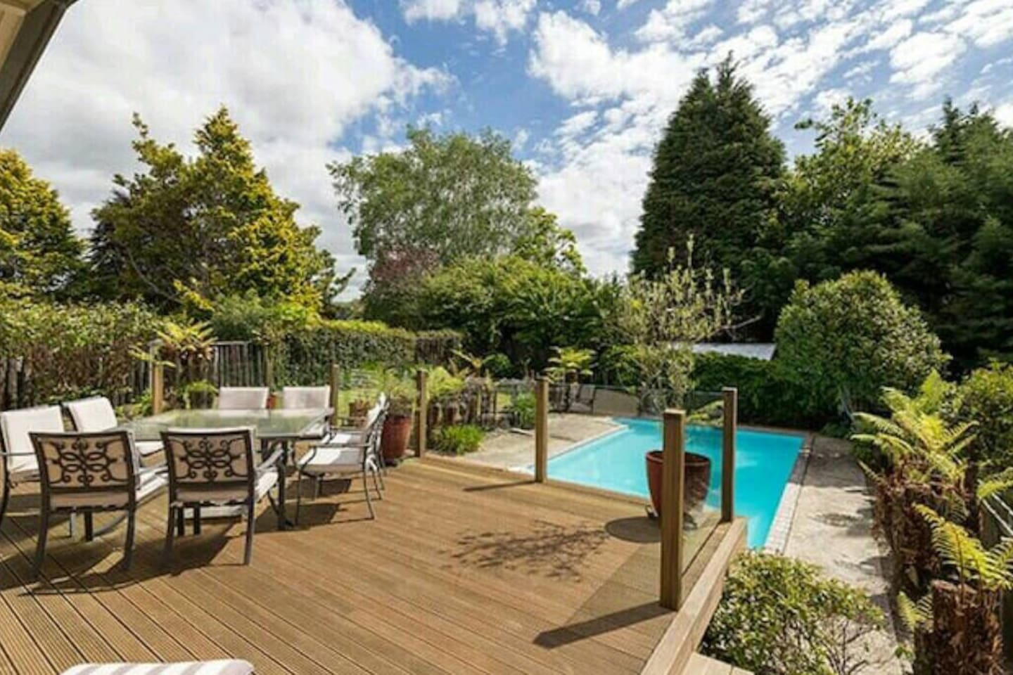 Best airbnbs in Rotorua for families featured by top family travel blogger, Marcie in Mommyland: The pool is separated by a secured gate and glass walls for the protection of your children.