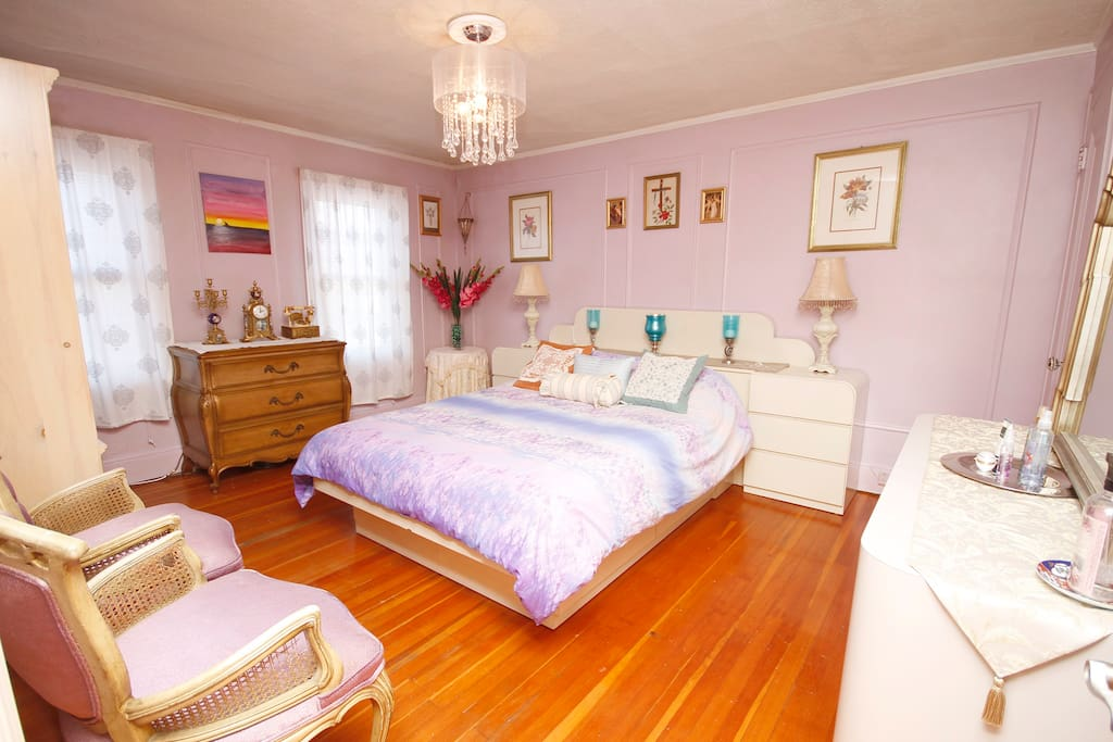 Large bedroom with ample storage and  lots of light.