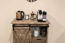 Coffee/tea bar downstairs with Nespresso, French press and electric teapot.