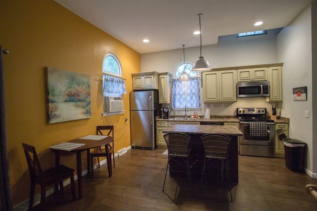 Full kitchenette with fridge/freezer, microwave, range/oven and dishwasher.