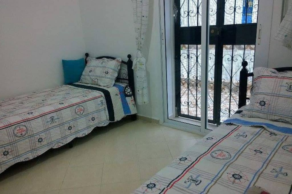 Chambre à coucher donnant sur terrasse