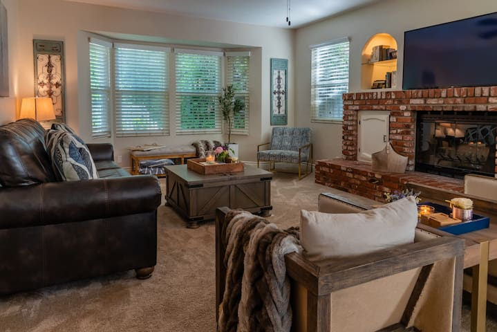 Spacious Living Room featuring a Queen Sleeper Sofa and a flat screen TV
