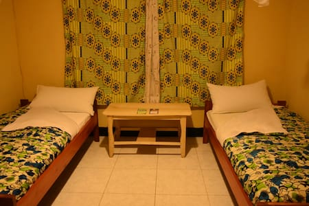 Amahoro Guest House - Triple Room Shared Bathroom