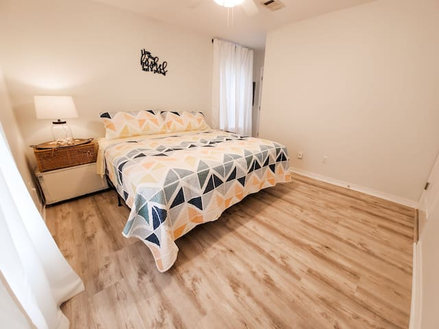 The main bedroom has a king size bed and walk in closet!