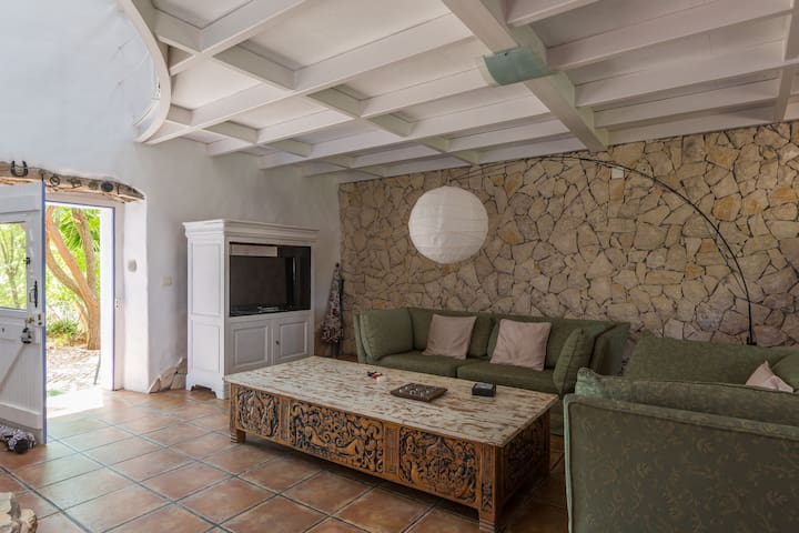 Comfortable sofa and spacious lounge,with  back door leading to your private garden with barbeque.