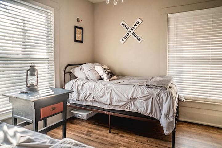 Coming into station like a locomotive.   Bedroom 5 is equipped with railroad artifacts.  This bedroom has 2 twin beds and tv.