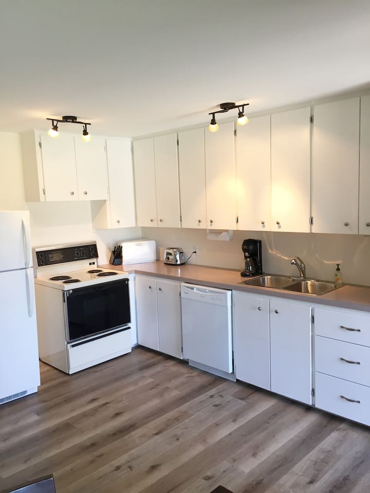 Kitchen includes dishwasher, coffee maker and all cookware and tableware during your stay.