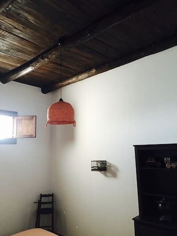 All the apartments have the wooden ceiling with exposed beams