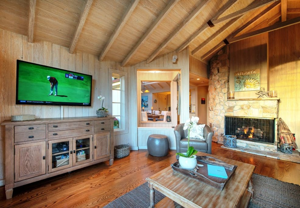 Large flat-screen TV and gas fireplace in the intimate living room.