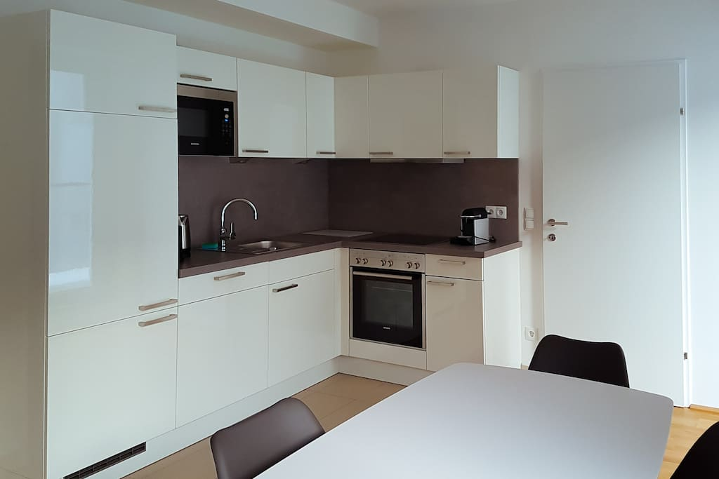 Fully equipped kitchen with oven, microwave, complimentary Nespresso coffee machine, large fridge and dishwasher