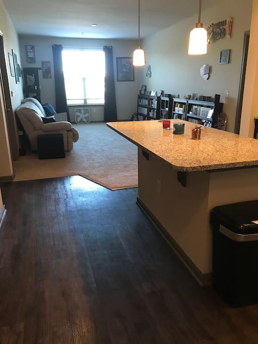 Open floor plan between kitchen and living room.