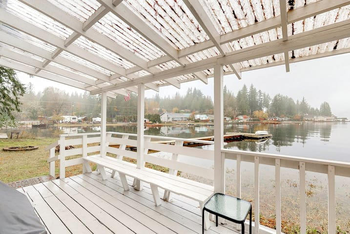 NEW LISTING! Sunny, waterfront cabin w/ a furnished deck, dock, & firepit!