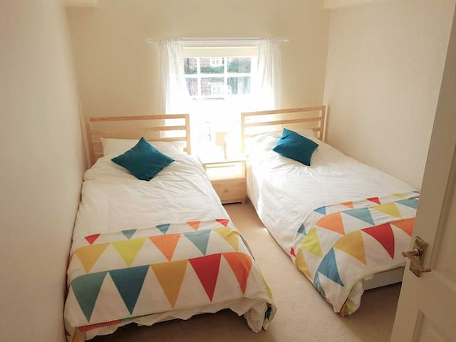 Twin room with full size single beds suitable for 2 adults if needed.