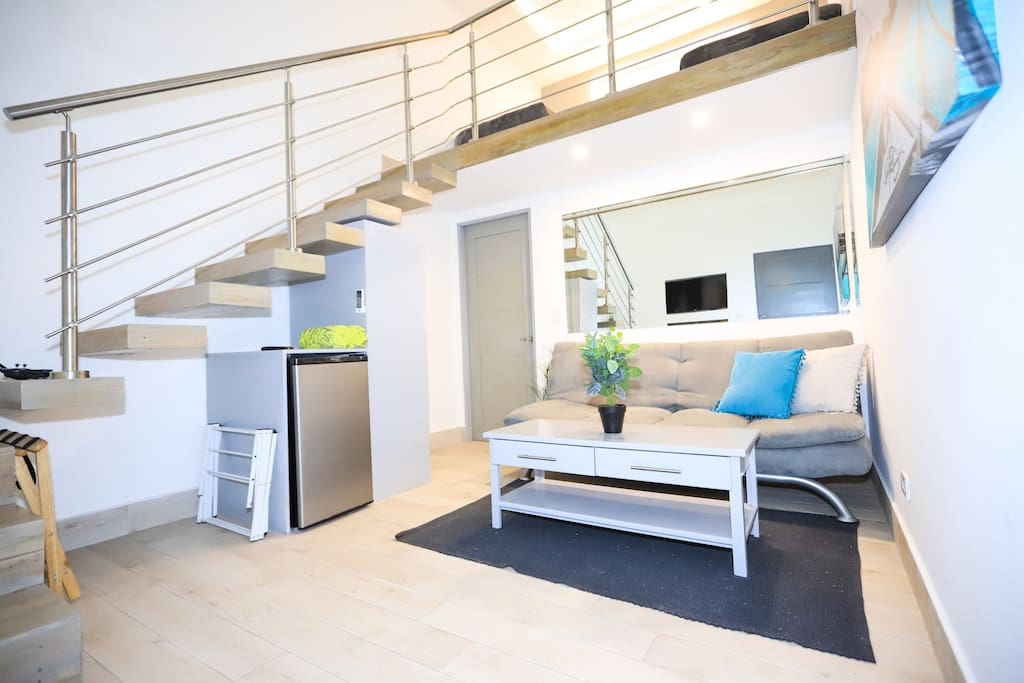 Enjoy the spacious downstairs living area with full futon for a 3rd friend to join you!  The floating teak stairs takes you up to the ocean view loft that features 2 comfortable single beds that will ensure a wonderful night's rest!