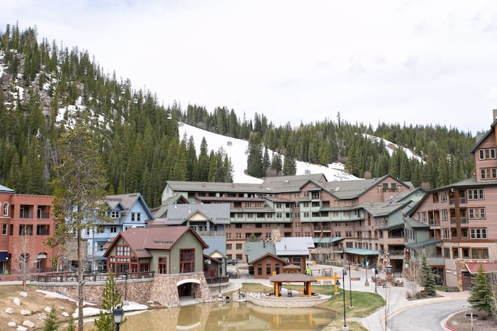 View from the amenities deck back to Winter Park Resort with views of The Gondola and ski runs.