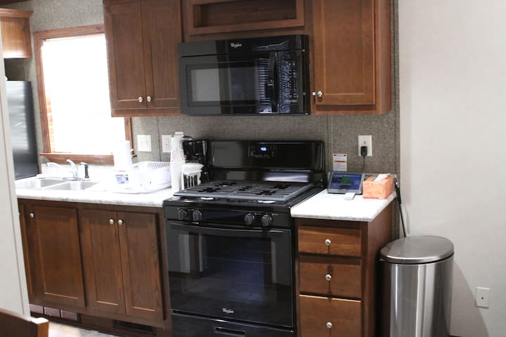 Propane stove and microwave oven.