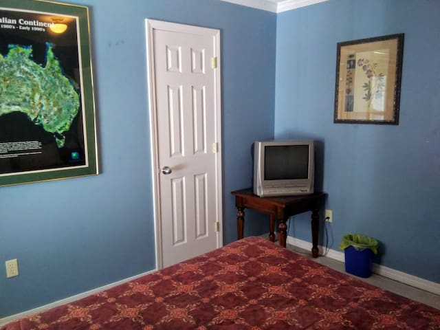 Third Bedroom contains a firm Queen-sized bed and a TV for watching DVD movies.