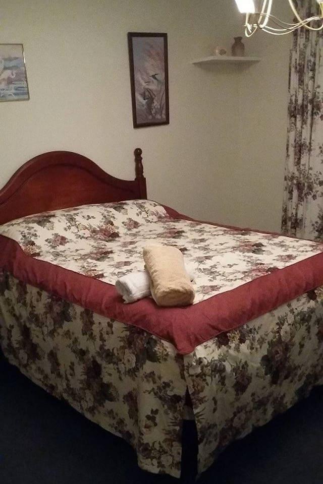 Large Bedroom has en-suite & walk in robe.